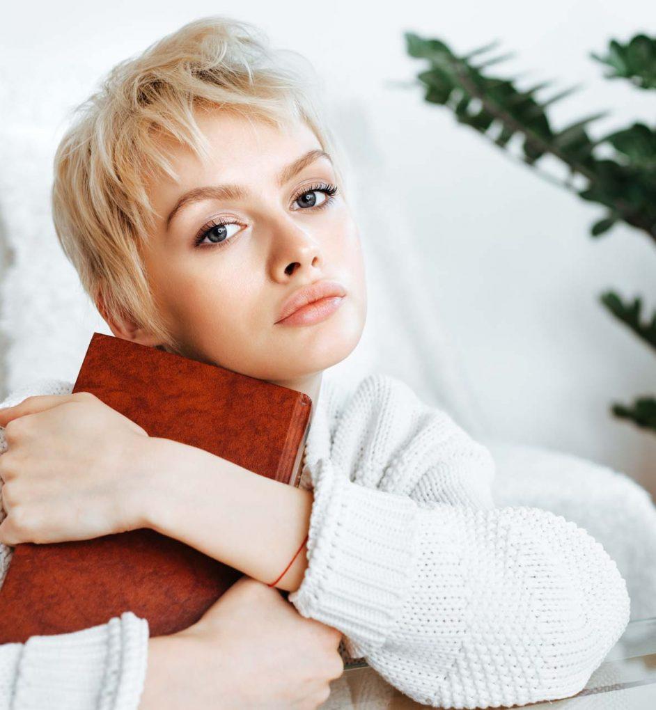 blonde-young-woman-wearing-sweater-P2RD2JJ.jpg
