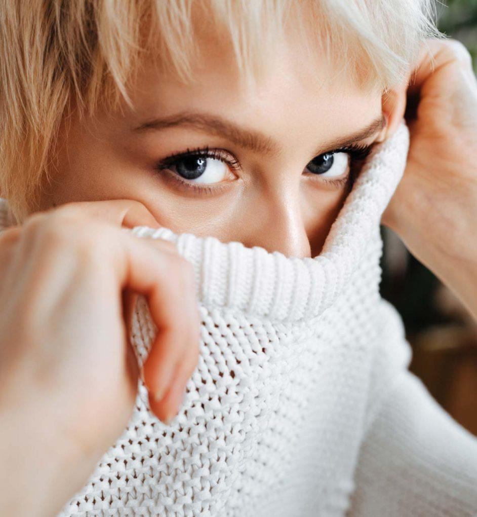 blonde-young-woman-wearing-sweater-P5APJ66.jpg