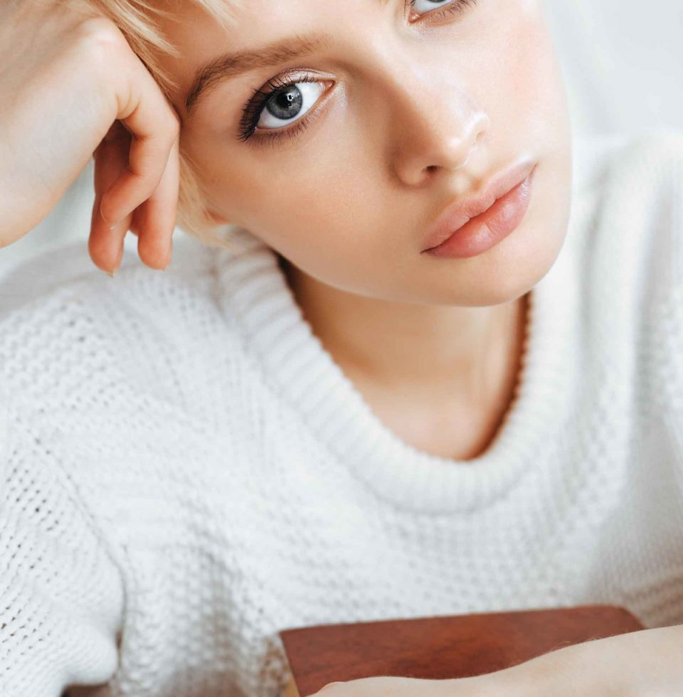 blonde-young-woman-wearing-sweater-PVSQXYK-scaled.jpg