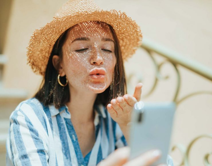 woman-making-a-video-call-from-her-phone-J8L7AKF.jpg
